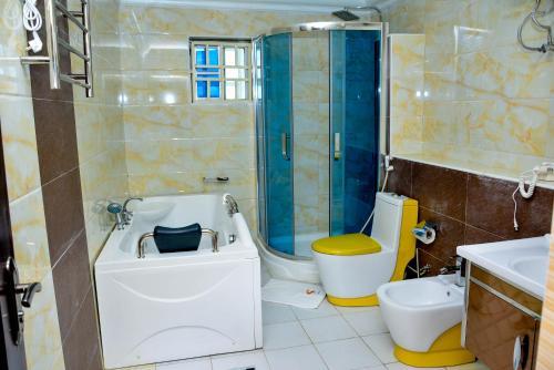 A bathroom at Crystal House International Hotel