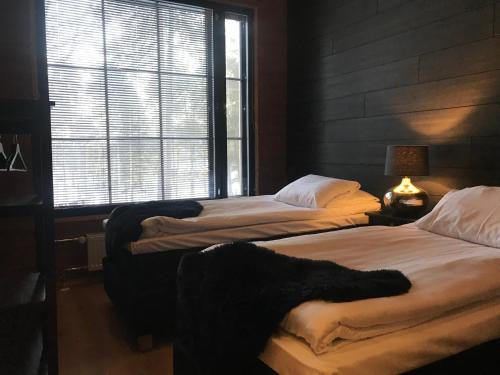 A bed or beds in a room at Wilderness Hotel Nellim & Igloos