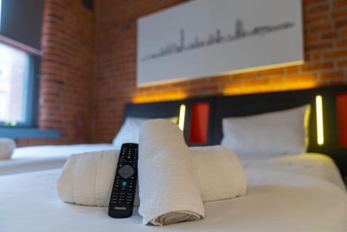 イージーホテル マンチェスターにあるベッド