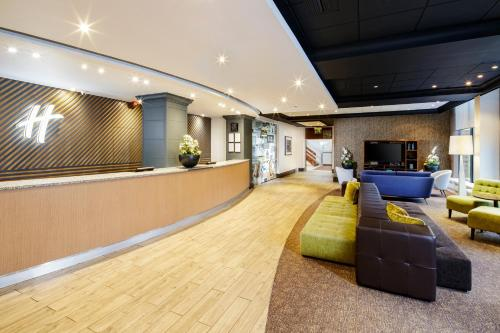 The lobby or reception area at Holiday Inn Peterborough West, an IHG Hotel