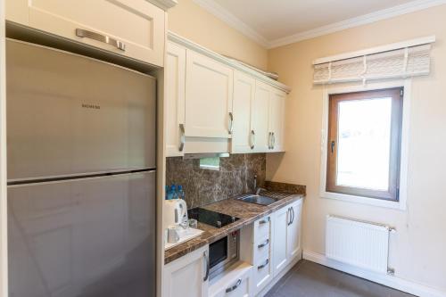 مطبخ أو مطبخ صغير في Qafqaz Riverside Hotel