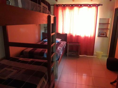 A bunk bed or bunk beds in a room at Hostel Serena