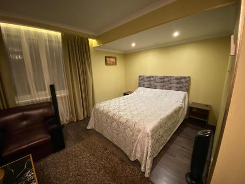 A bed or beds in a room at Zhar