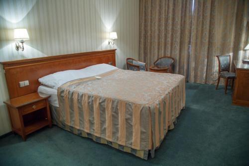Кровать или кровати в номере Гринн Отель и Спа