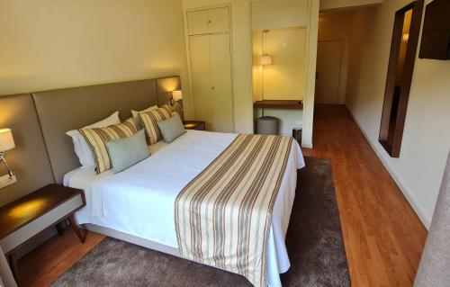 Un ou plusieurs lits dans un hébergement de l'établissement Hotel Eden