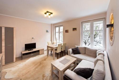 Część wypoczynkowa w obiekcie Gdańskie Apartamenty - Old Town Grobla Rooms & Apartments