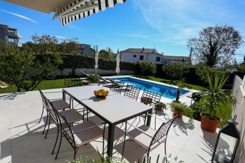 The swimming pool at or close to Villa Elysium - beautiful house with heated pool