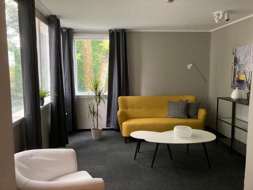 Et sittehjørne på Parken Terrasse Apartment Hotel
