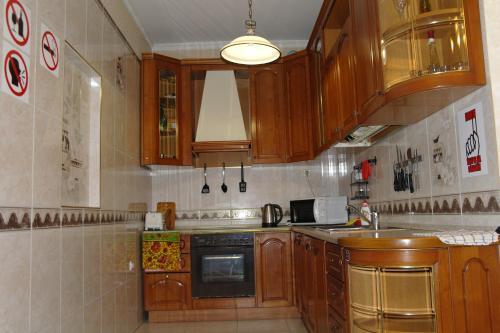 A kitchen or kitchenette at Хостел на Фрунзе 63