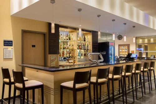 The lounge or bar area at Holiday Inn Express Frankfurt Messe, an IHG Hotel