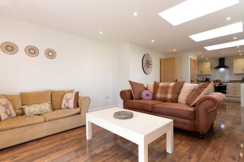 A seating area at Breckland Cottage - Secluded Country Getaway