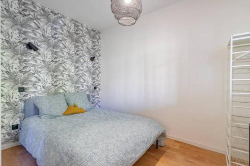 A bed or beds in a room at Charmant T2 climatisé - Canebière et Vieux-Port