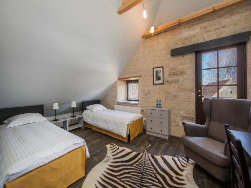 A bed or beds in a room at Pidula Mõisa külalistemaja - Pidula Manor