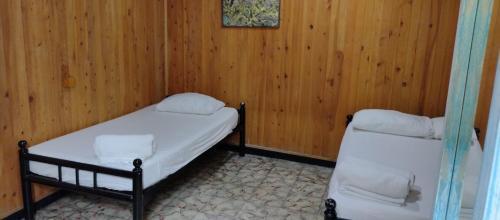 Een bed of bedden in een kamer bij Hostel Mamabella