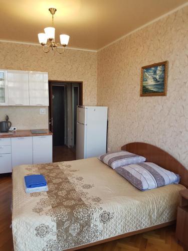 Кровать или кровати в номере Апартаменты Берег Черного моря