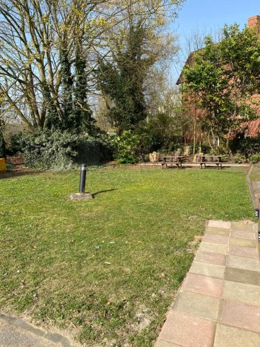 A garden outside Carlton lodge with free parking