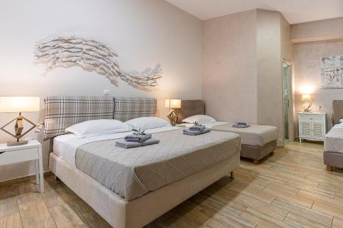 A bed or beds in a room at Comfort Stay Airport Boutique Hotel - FREE shuttle from the airport
