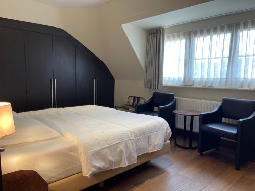 Un ou plusieurs lits dans un hébergement de l'établissement Villa Hotel (Adults only)