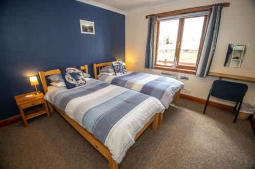 A bed or beds in a room at Arle Lodge