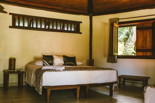 A bed or beds in a room at Canto d Alvorada Hotel Pousada