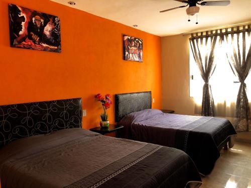 Cama o camas de una habitación en Hotel Jatziri