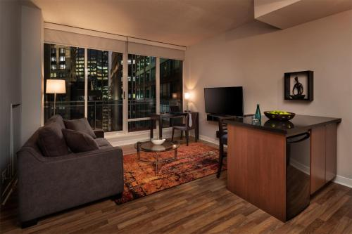 A television and/or entertainment center at Executive Hotel Cosmopolitan Toronto