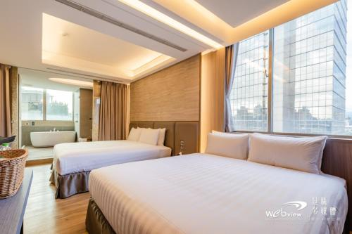 A bed or beds in a room at Wow Happy- Taipei
