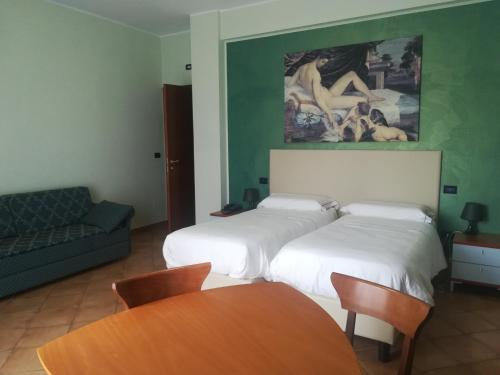 A bed or beds in a room at Hotel Residence Azzurro