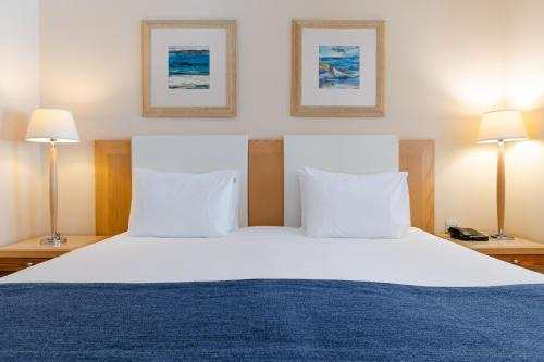 Un ou plusieurs lits dans un hébergement de l'établissement Maritim Antonine Hotel & Spa