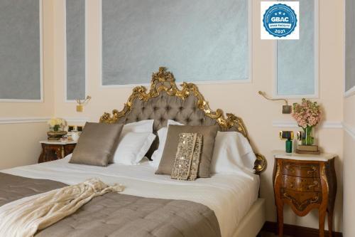 Cama ou camas em um quarto em Hotel Bernini Palace