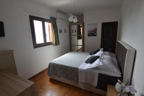 A bed or beds in a room at Guest House Torci 18