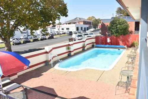 The swimming pool at or near Best Western Motel Farrington