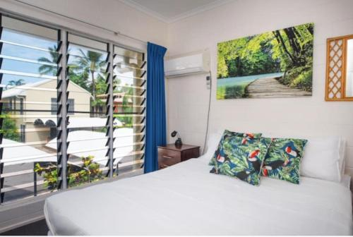 A bed or beds in a room at mango tree private townhouse
