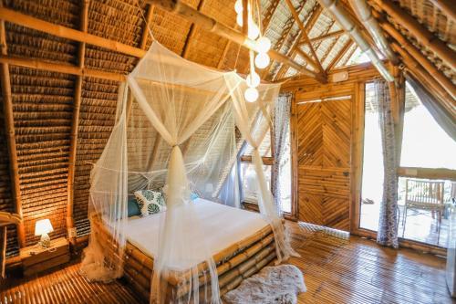 Cama o camas de una habitación en Tongo Hill Cottages