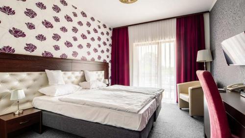 Ein Bett oder Betten in einem Zimmer der Unterkunft Session Hotel Ráckeve