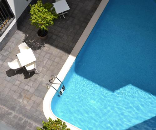 Вид на бассейн в Hotel Do Colegio или окрестностях