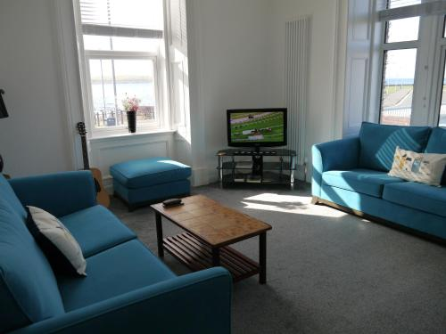 A seating area at Gogo Vale Apartment