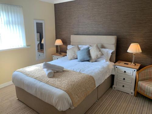 A bed or beds in a room at The Abercrave Inn