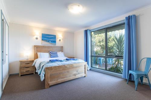 A bed or beds in a room at Relax in San Remo
