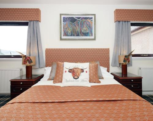 A bed or beds in a room at Ardentorrie Guest House