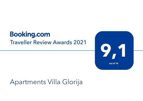 Certifikat, nagrada, logo ili neki drugi dokument izložen u objektu Apartments Villa Glorija