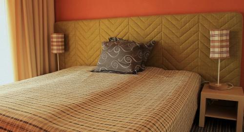 Voodi või voodid majutusasutuse Kaluri Residence toas