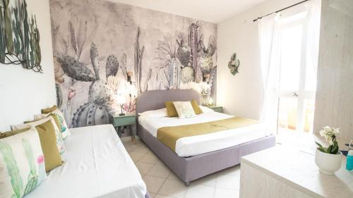 A bed or beds in a room at Hotel Il Perseo