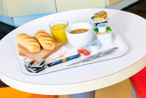 Breakfast options available to guests at Premiere Classe Marseille Vitrolles Anjoly