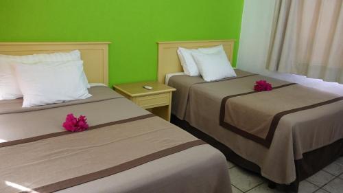 Cama o camas de una habitación en Sunrock Condo Hotel
