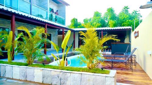 The swimming pool at or near Casas Peroba Maragogi