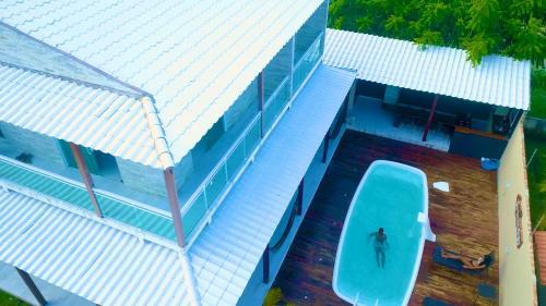A view of the pool at Casas Peroba Maragogi or nearby