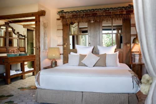 A bed or beds in a room at U Capu Biancu