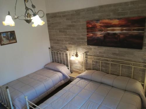 A bed or beds in a room at Casa Vacanze Nantò