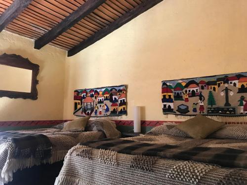 Una cama o camas en una habitación de Rancho Cumbre Monarca